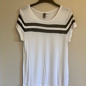 White tee with black mesh stripes.